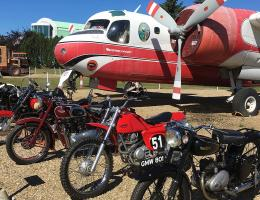 Motorcycles in front of a plane
