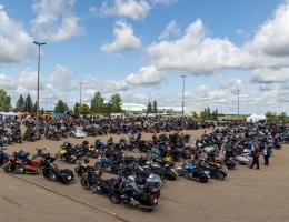 Riders create a display of hundreds of bikes in the museum parking lot.