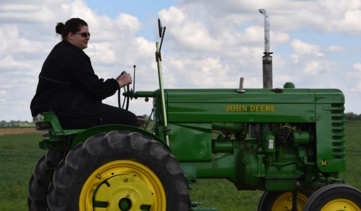 Driving a John Deere tractor is just part of the fun